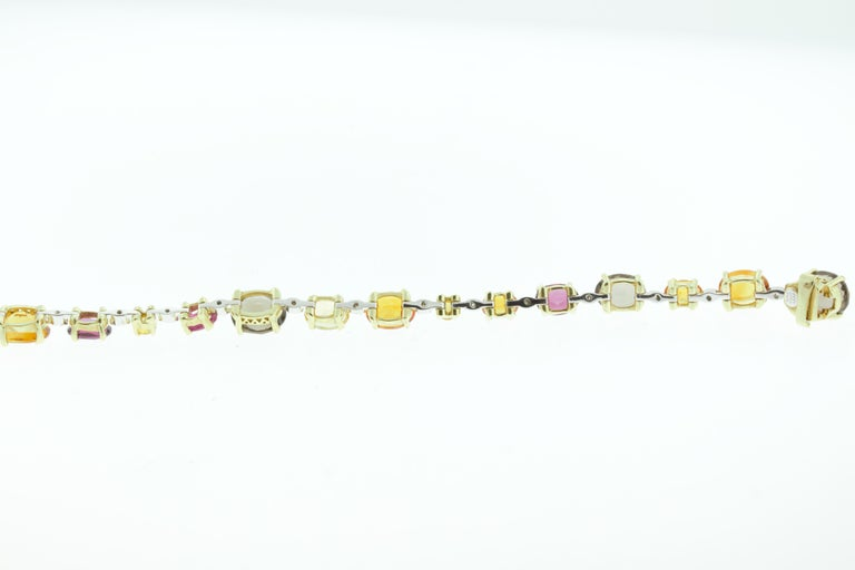 This Ponte Vecchio bracelet features 15.98 carats of sapphire, 1 carat of ruby, 0.14 carat of diamond set in 18K yellow and white gold. 14.30 grams of gold. 7 inch length. Made in Italy.   Viewings available in our NYC showroom by appointment.