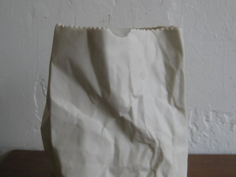 Great vintage porcelain paper bag vase sculpture made by Hawaii's Ceramic Art Studio. The bisque porcelain sculpture is marked on the inside by the maker. It has a wonderful pop art design and form. In excellent shape with no condition issues.