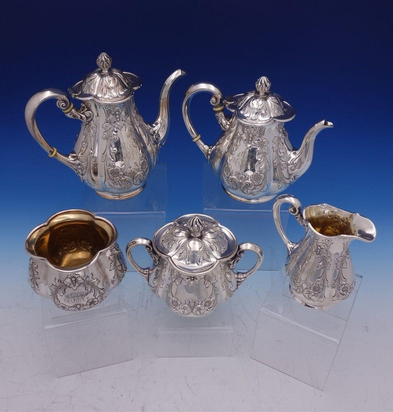 Charming Poppy by Gorham silver plate 5-piece tea set. The pieces are marked #0352 and are monogrammed (see photos). This set includes: One coffee pot: Measures 9 x 8 1/4 . One tea pot: Measures 8 1/2 x 7 1/4 . One sugar bowl (with lid):