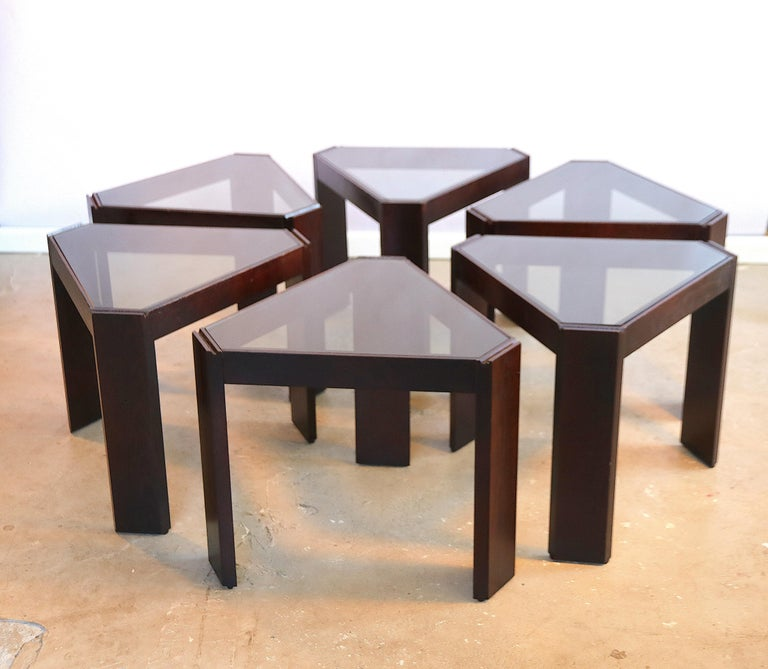 Wonderful set of multi functional side tables by Porada Arredi, Italy, 1970s. You can make figures on the floor with the triangle shaped frames, set them anyway you like, and also stack them on top of each other to create an étagère or display unit;