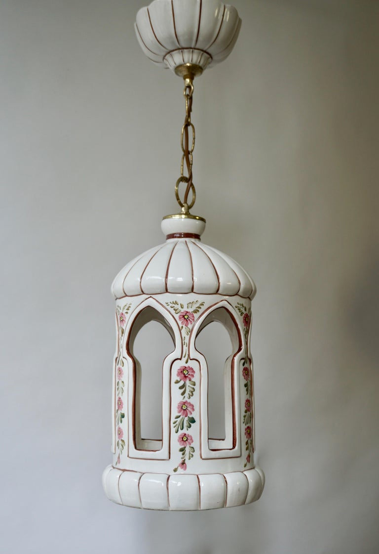 Italian porcelain lantern or pendant light in brass and porcelain painted with flowers.