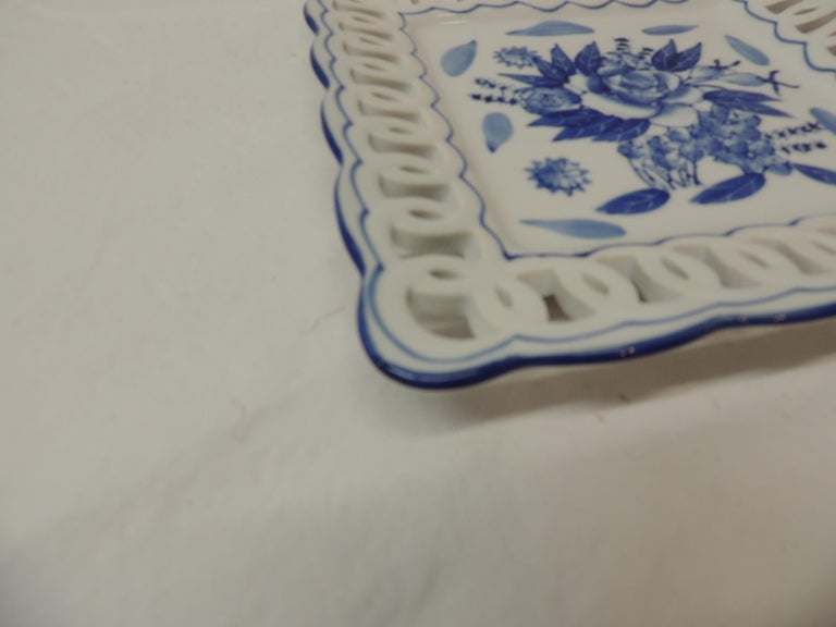 Porcelain blue and white dish with pierced border edge. Ideal as a coaster or catchall plate. Measures: 8