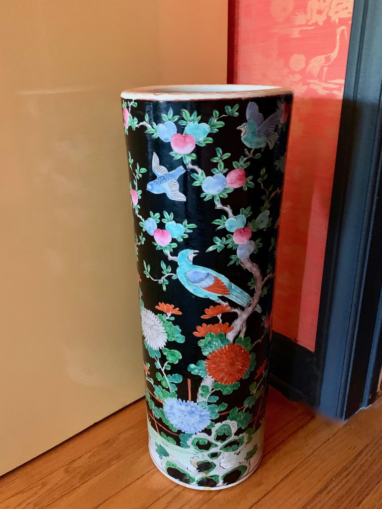Porcelain Chinese umbrella stand vase - Classic bold colors in designs of flowers, birds, and foliage. A handsome hand painted compliment to any entry, and at 18 pounds a substantial piece that will hold any number of umbrellas. Also a wonderfully