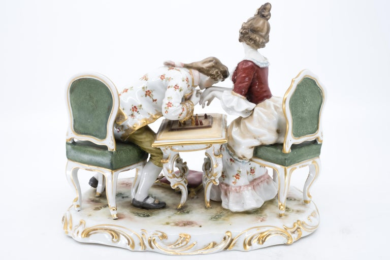 Hand-Painted Porcelain Figurine of a Couple Playing Chess, Germany, Hand Painted For Sale
