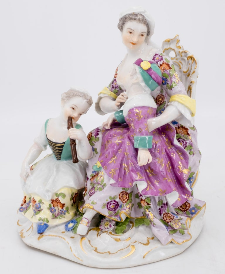 A figurine of a mother and two children, the girl playing the flute German, Meissen, mid-18th century, marked for Meissen, porcelain, Germany with double crossed swords in under-glaze blue  *Shipping included   Free and fast delivery door to door by