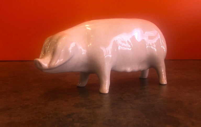 Whimsical porcelain piggy bank by Bovey Pottery of Devon, England, circa 1930s.