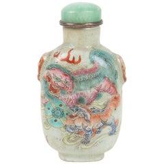Porcelain Snuffer with Four Shishi Decor Facing Among Clouds on Celadon Backgrou
