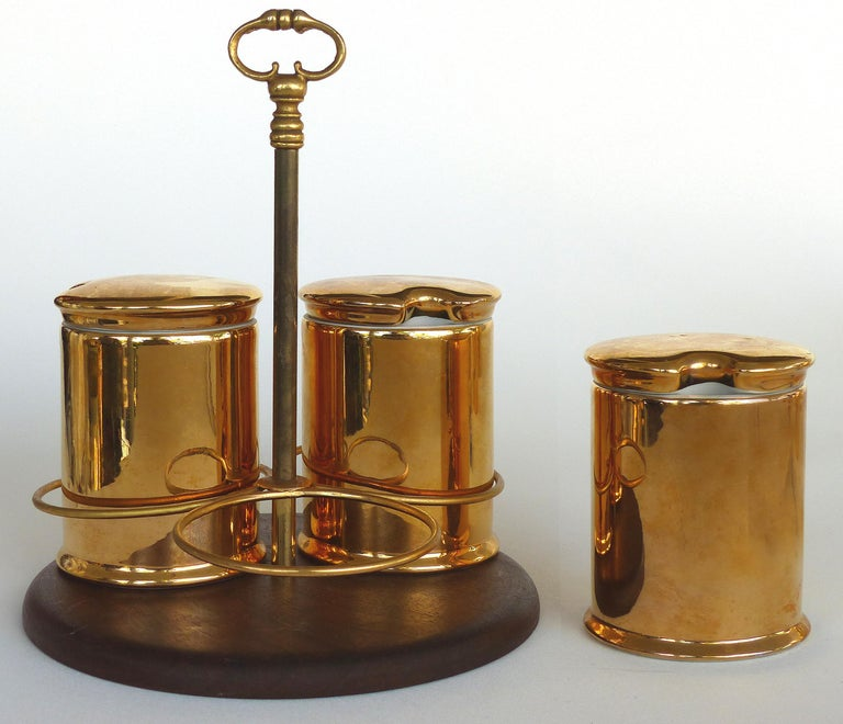Porcelaine de Paris Gold Lustre Lidded Condiment Jars and Stand  Offered for sale is an unusual set of porcelain de Paris Gold Lustre lidded condiment jars and stand, the jars are fully marked and retain their lids. The stand is easily carried with