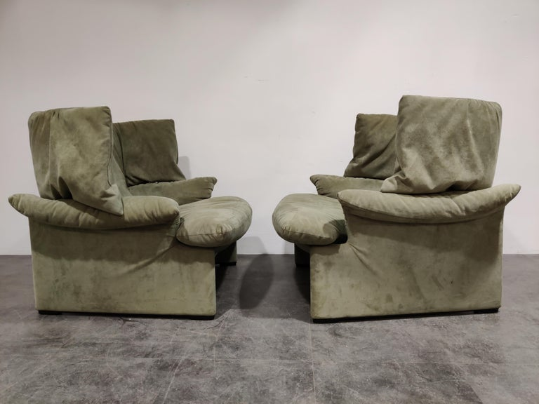 Pair of exquisite olive green velvet portovenere wingback chairs designed by Vico Magsitretti for Cassina.