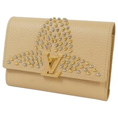 portofeuilles  Capucines compact  Folded wallet M63953  beige Leather