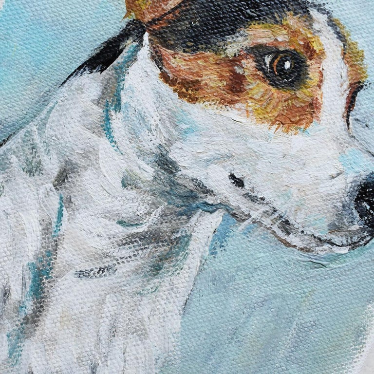 A small portrait painting of a terrier dog on canvas. The painting's subject glances off to it's side with an eager look on its face. Black and brown spots cover the head and ears on it's white body. The background is in a beautiful pale blue.