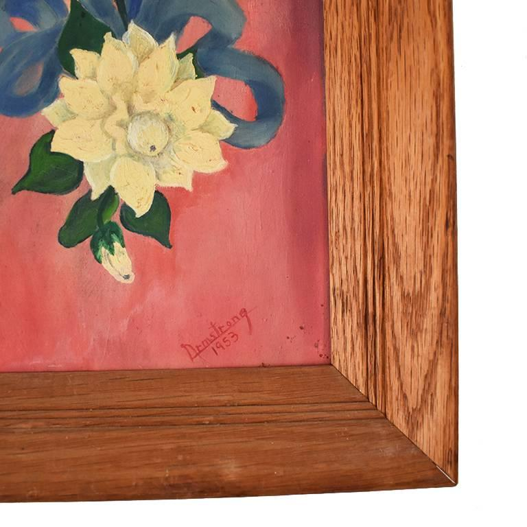 Portrait of lady in pink with blue background. Woman in adorned with a white flower and blue ribbon details. This piece is framed in a wooden frame. Beautiful for any gallery wall. Pair it with several other portraits for a gallery wall of vintage