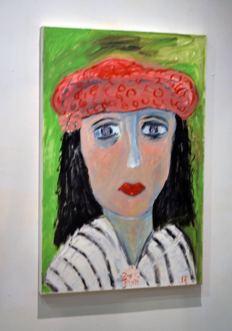 This exceptional Expressionist painting titled Portrait of Lady With Red Beret Against Green, Artist #1'18 is by highly listed and respected self-taught artist JoAnne Fleming (b. 1930). The artist's characteristic style exudes a primitive quality to