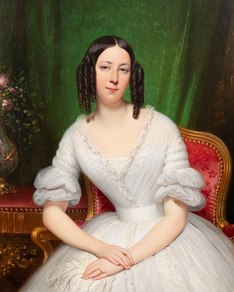 High quality portrait representing a young woman wearing a white dress in a bourgeois interior. We must thank Mr. Jean Loup Legay, an expert on Joseph-Désiré Court, for identifying the model: