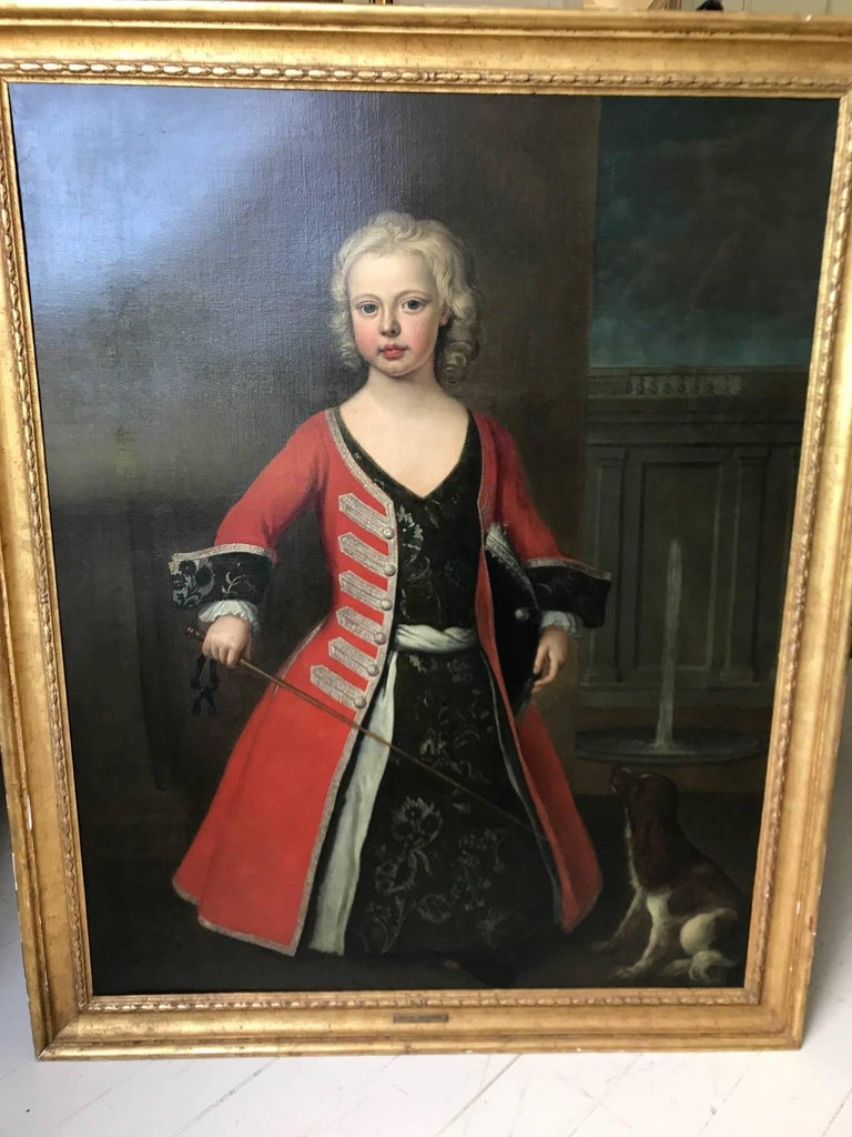 A portrait of prince William son of king George II. Oil on canvas painted by the Joseph Highmore. Depicting William as a young boy, in military dress. He appears to be brandishing a fencing sward or large riding crop with his faithful dog at his