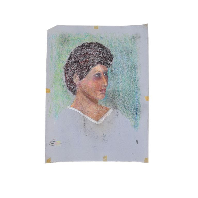 A lovely portrait sketch by Oklahoma artist Clair Seglem. This piece depicts a woman with short dark hair and a light blue v neck shirt. This piece is on blue paper. Measures: 18