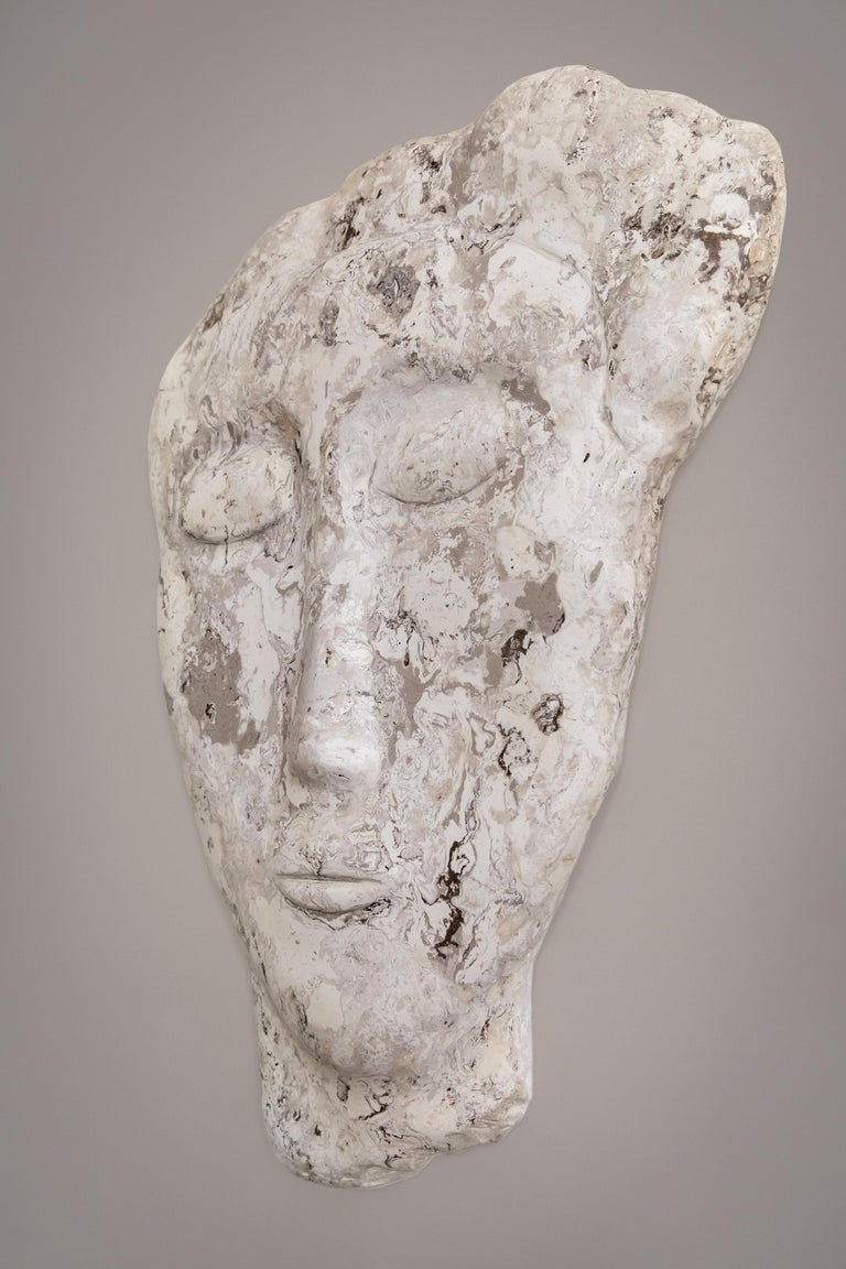 A wall mounted large size sculpture, hand crafted in scagliola composite. Sculpting in this marble like material is rather unusual, yet not dissimilar to carving in stone. A labour intensive process, the wall sculpture with its serene expression,