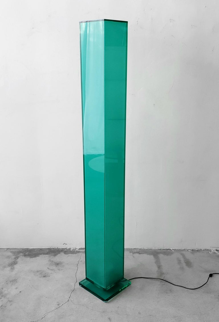 A Postmodern and contemporary floor lamp. Very simple, clean lines. Acrylic is a beautiful translucent sea glass green color. Illuminates from the bottom with a single flood bulb.  Lamp works perfectly and is in excellent condition.  Measures: