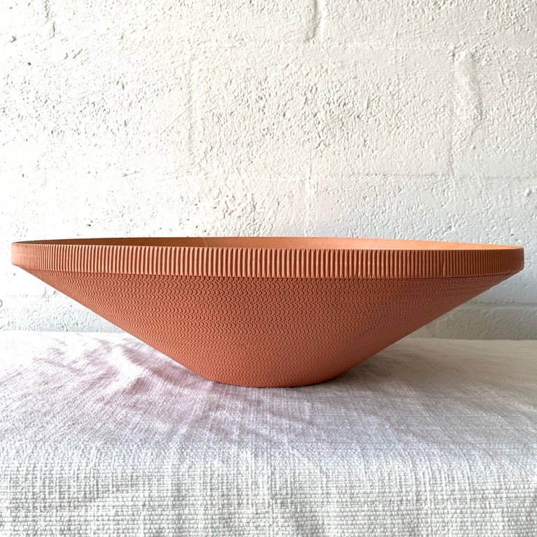 Postmodern bowl or vessel rendered in mauve pink painted corrugated cardboard, reminiscent of easy edges line by Frank Gehry.
