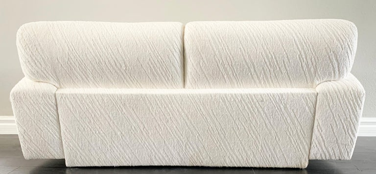 Available right now we have this gorgeous white loveseat sofa. This sofa's curves rival that of Kim Kardashian any day! The curvy silhouette and cool modern plinth base give this Postmodern sofa a wonderful, clean look that is sure to bring a touch