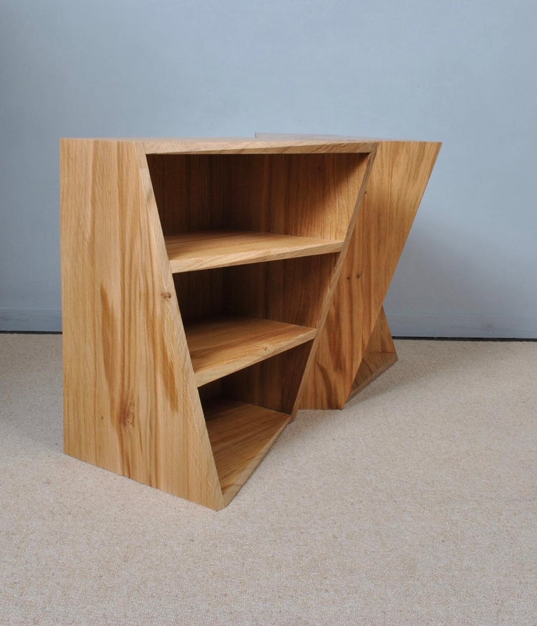 The Post-Modern oak nightstands can be utilised as side or end tables/bedroom night-stands. The acute twisted angle design fools the eye in a similar fashion to the Penrose and Escher impossible staircase. The shelf fronts have a twisting bevelled