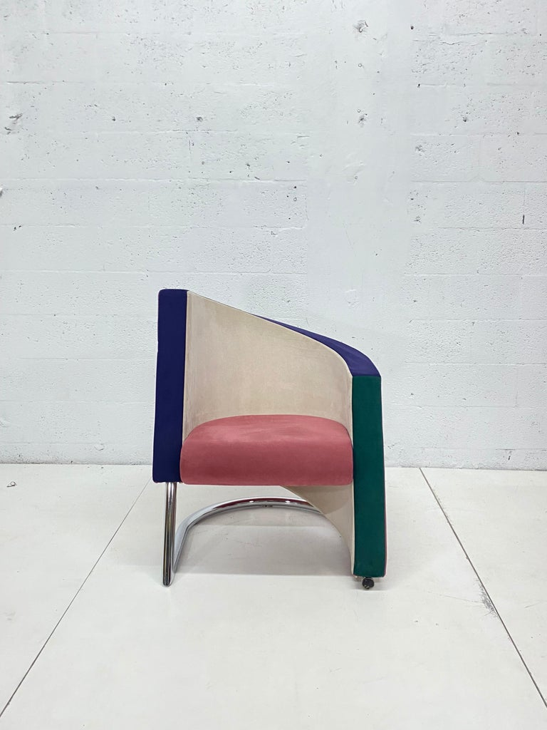 Pair of multi-color ultra-suede postmodern opposing club or lounge chairs produced by Westnofa, Chicago. Chairs are produced with foam over a steel frame and attached to a tubular chrome base. Upholstery is original and there is some puffiness on