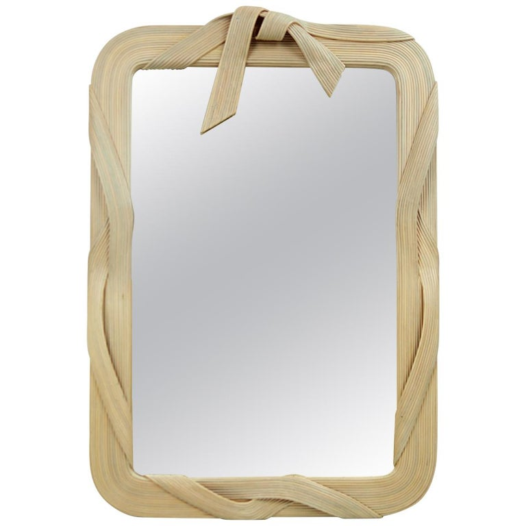 Postmodern Rattan Mirror in the Shape of a Ribbon with Bow by Betty Cobonpue For Sale