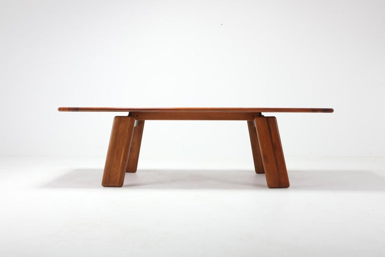 Walnut dining table by Afra & Tobia Scarpa   This impressive piece fits 8 to 10  Amazingly beautiful pieces of walnut have been used to construct this postmodern piece. through it's design the table top kind of floats over the trapezoid