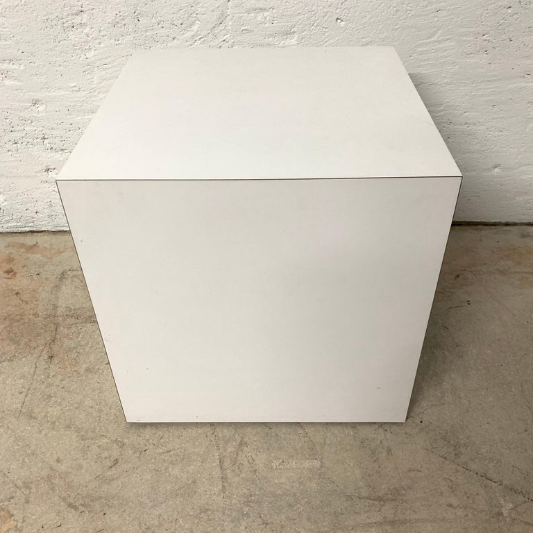 Postmodern cube table rendered in white laminate.