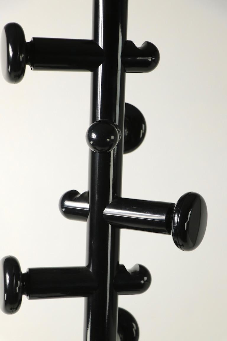 Post Modern coat tree stand in high glass black finish ( base is matt finish ), having six hooks for coats, scarves and hats. Sturdy, stable and well made, clean and ready to use. We believe the coat stand is Italian made, it is unsigned.