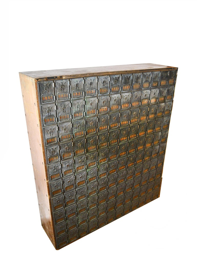 This uniquely crafted mailbox unit features 120 separate compartments made of lovely bronze. Intricately detailed eagles holding 3 arrows and olive branches adorn each compartment door giving this mailbox even more character. The motif is a symbol