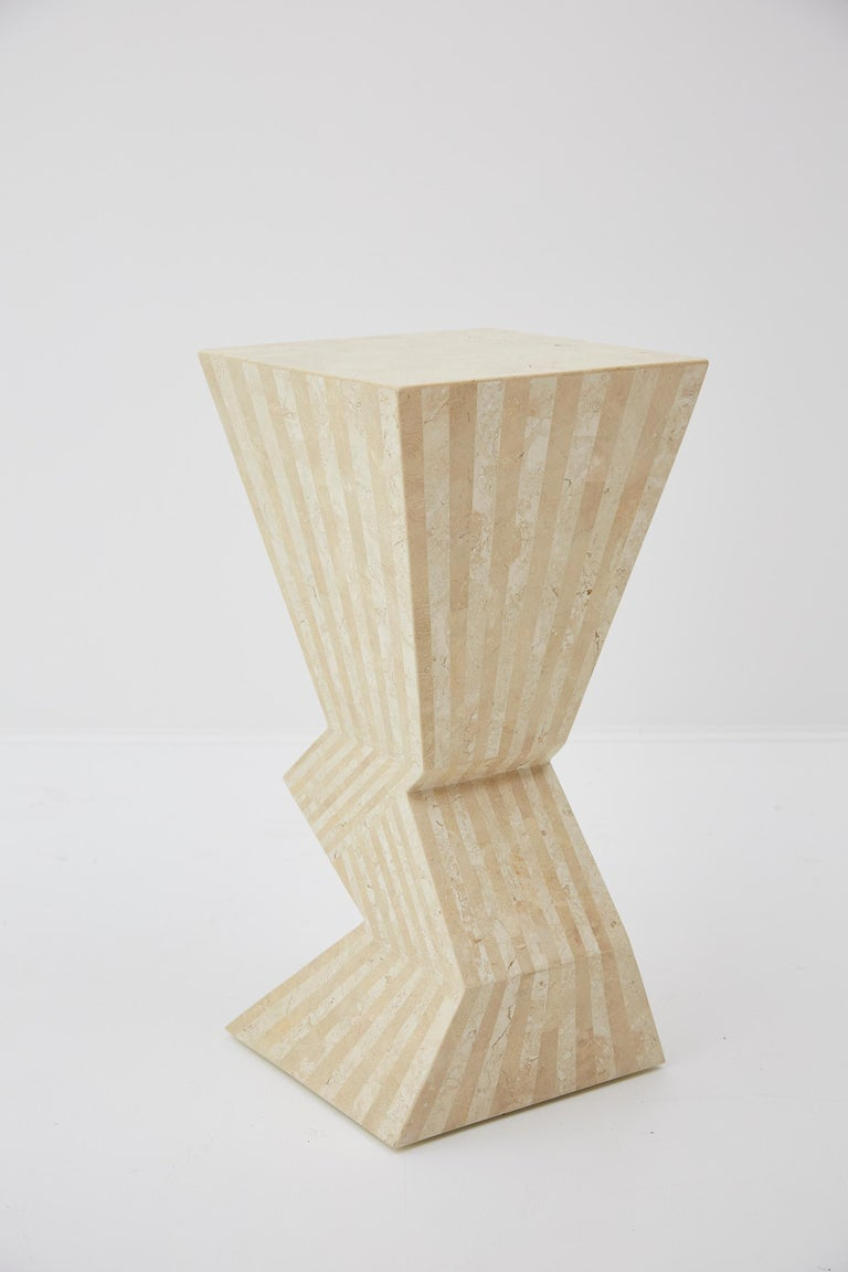 Zig-zag pedestal fully covered in tessellated beige fossil stone with white ivory stone. Postmodern styling. Measures: 29'' tall.