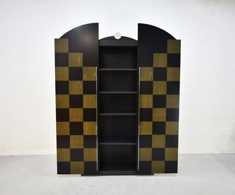 Postmodern style cabinet 'Cubic' was designed in the late 1980s by German designer Peter Maly for Munich based company Reim Interline  This high-end cabinet was part of the 'Facades' series that consisted of five different models of