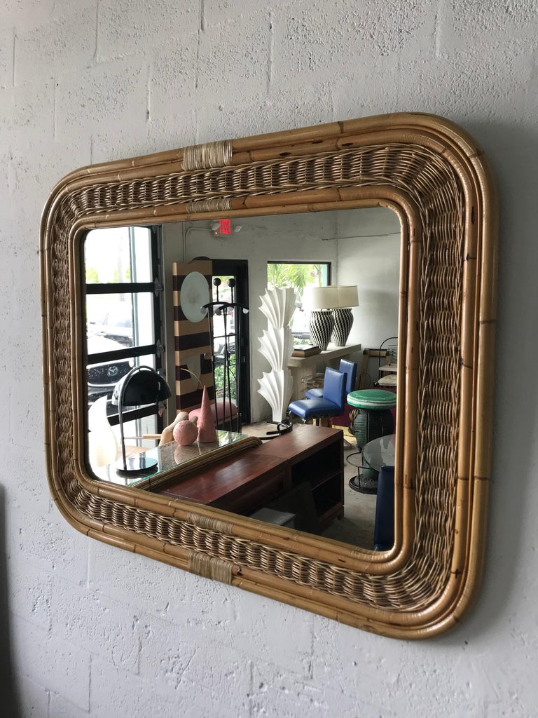 Bamboo wicker rattan framed mirror with rounded corners, can be hung vertically or horizontally.