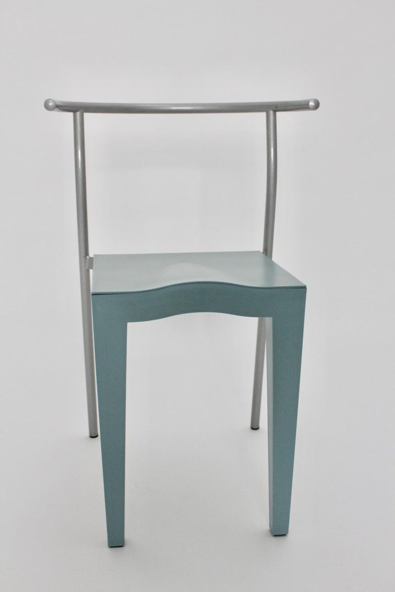 Postmodern light blue vintage chair was designed by Philippe Starck in the 1980s and executed by Kartell Italy. The chair shows grey lacquered tube steel feet furthermore the seat and back were made of light-blue propylen. Very good vintage