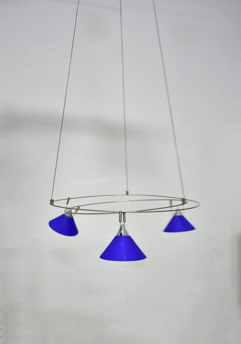 Minimalist chandelier from the postmodern era, Germany, 1980s  Unknown manufacturer and designer  This elegant minimalist chandelier features a large metal ceiling rose with an adapter hidden inside and a light-weighted circular hanging