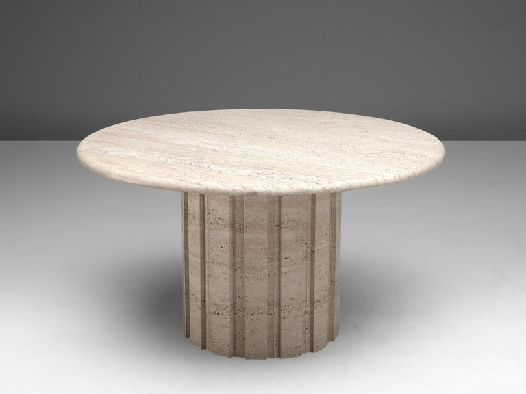 Round dining table, travertine, Germany, 1970s  This archetypical center table is a skillful example of postmodern design. The table is executed in travertine. The round table features no joints or clamps and is architectural in its structure. The