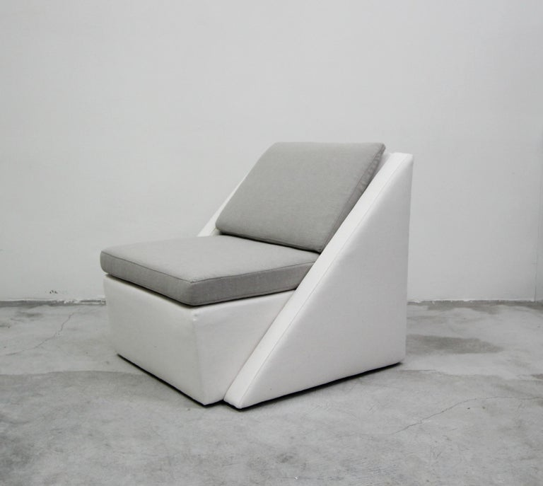 Rare geometric chair and ottoman, with a very postmodern feel. Love the linear lines and shapes that this unique piece has. Never seen anything like it.