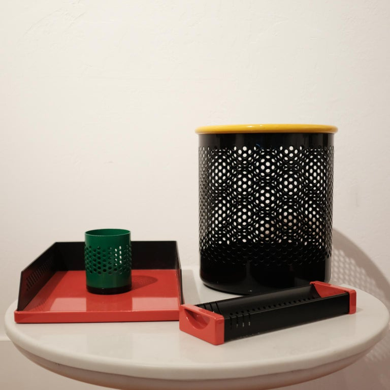 Postmodern Italian desk set, including a letter tray, pencil cup, catchall with card holder and a wastepaper basket. Perforated metal with plastic. Designed by Barbieri & Marianelli for Rexite, Italy, 1981.