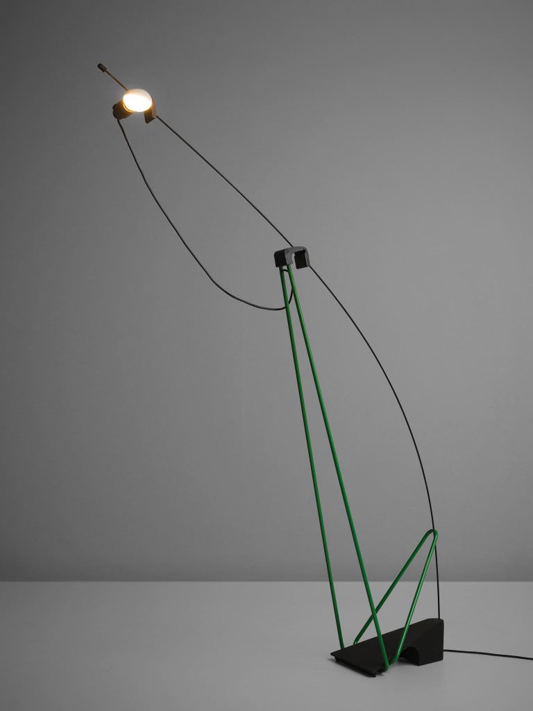 Floor lamp, green and black, polyester and steel, Italy, 1970s.  This playful, graphic floor lamp is designed to be an eyecatcher in every modern interior. The lamp holds a solid steel base and playful black and green lines that go both horizontal
