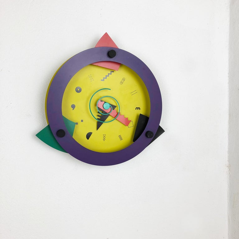 Article:  wall clock Memphis style    Origin:  Japan   Producer:  Wakita Paradise   Age:  1980s    Description:  this original metal postmodern wall clock was designed by Shohei Mihara and produced in the 1980s by the premium