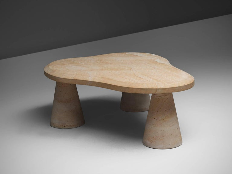 Side table, sandstone, Italy, 1970s  This sculptural piece exists of three colon legs with a free form cloud like shaped top. The legs are placed beneath the three far ends of the cloud figure. The piece is a true example of Postmodern design.