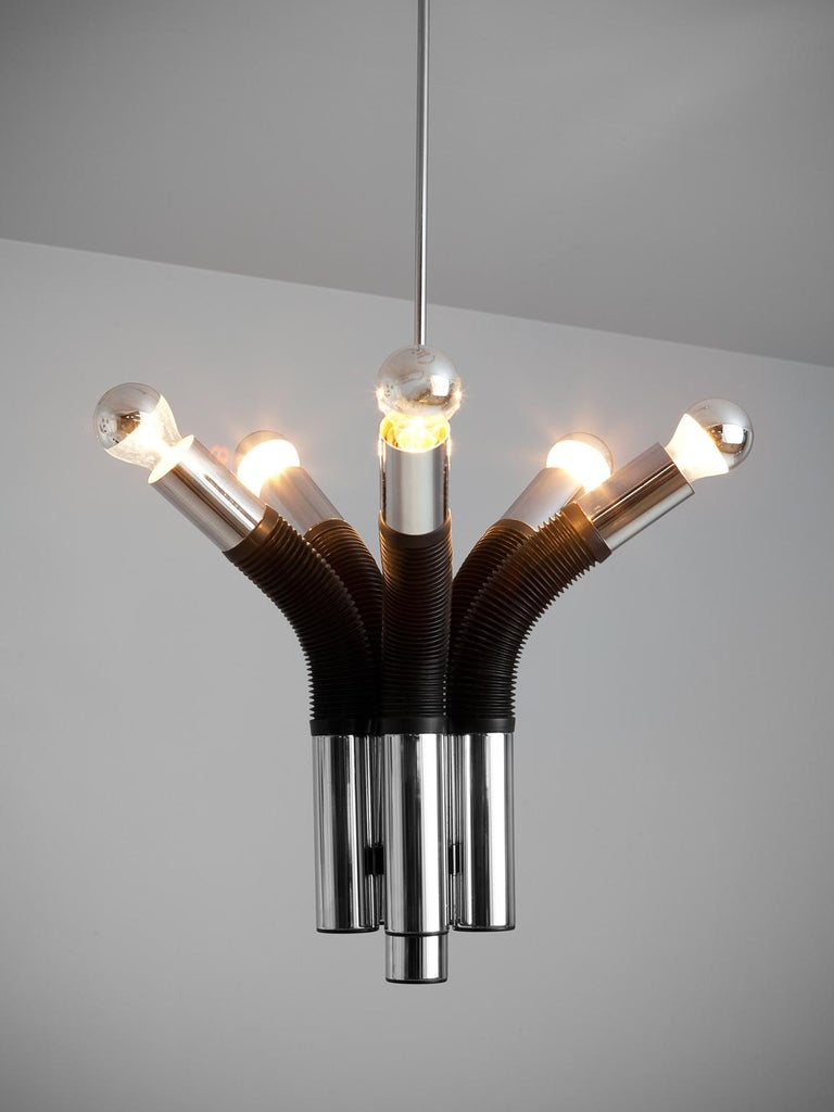 Targetti Sankey chandelier, made in chromed metal and plastic, Italy, 1970s.   This chandelier made out of five pipes, is a modern way to interpret lighting. With the pipes which present half of rubber body, they open up as if a flower. This