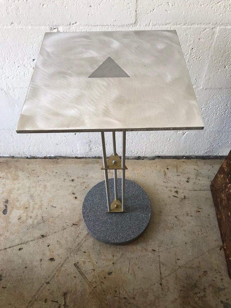 Postmodern Memphis style telephone accent occasional side end or drinks table, rendered in steel and brass with a tromp l oeil granite base.