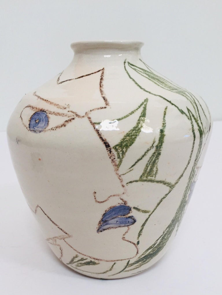 I am totally in love with this postmodern vase with abstract head portraits figures in Jean Cocteau style, the Taureaux. Hand painted with abstract head in Picasso and Cocteau style, very unique and elegant would form a real statement piece in any