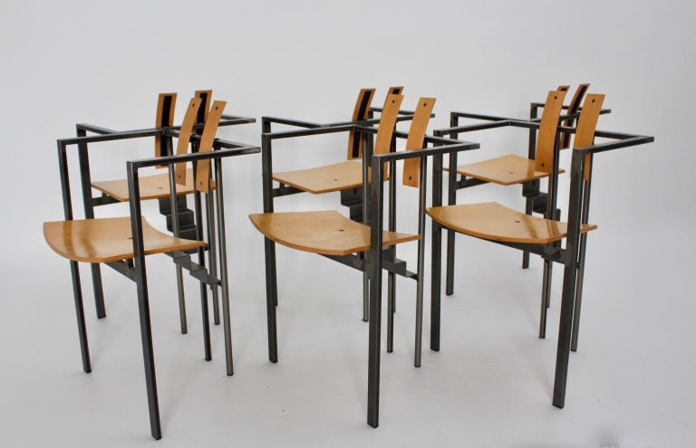 We present a set of six postmodern dining chairs. The dining chairs are a construct of pure metal, furthermore the seat and the back were made of natural lacquered beech plywood. The eye catcher of this set are the step-shaped connections between