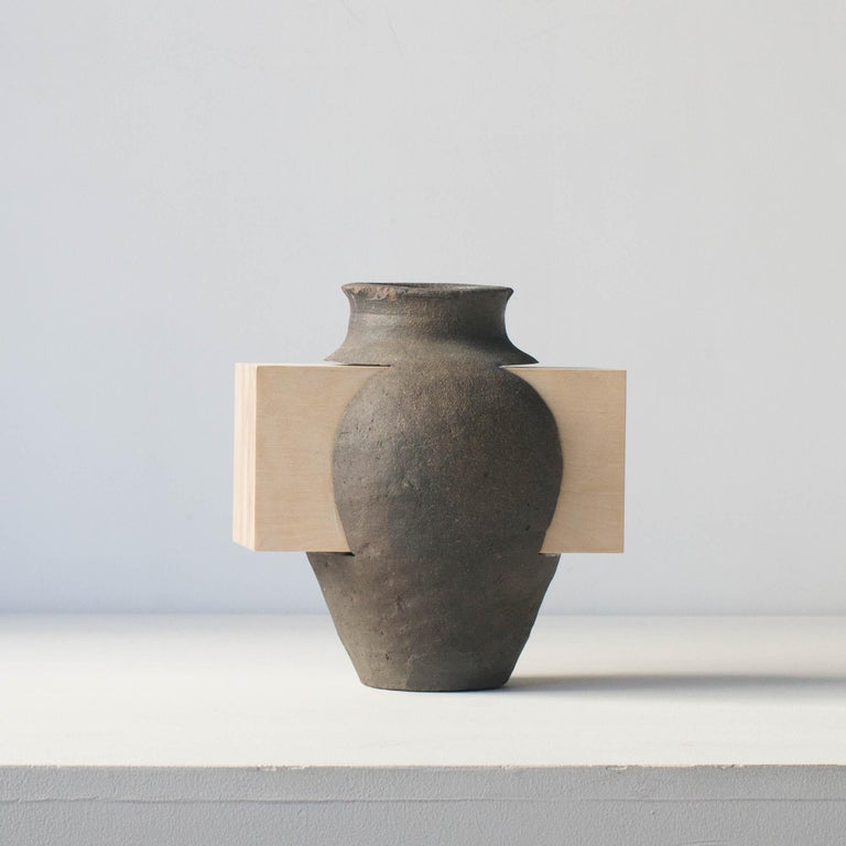 This series of ceramics are unique work by Norihiko Terayama.  This is one of series of practicing relationships with function and decoration. Artist tried to make decoration that defeats function vase originally had. This unique piece has wood
