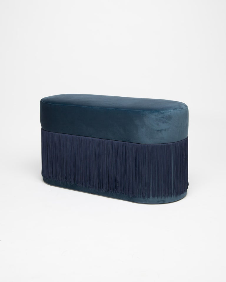 Pouf Pill L by Houtique Dimensions: H 45 x 80 x 35 cm Materials: Velvet upholstery and 30cm fringes  Pill Pouf L Art-deco style pouf with wood structure and velvet fabric. 2 fiber-board discs of 16mm, joined by wooden tufts. Upholstery Velvet
