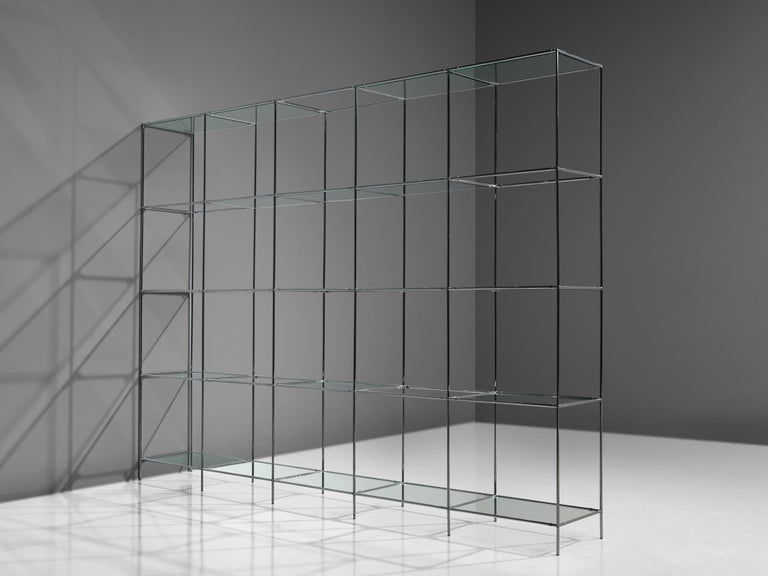 Poul Cadovius for Royal System, modular shelving unit and roomdivider, glass and chrome-plated steel, Denmark, 1960s.  This Minimalist shelving unit was designed by Poul Cadovius (1911-2011) and produced by Royal System, Denmark, circa 1960. This