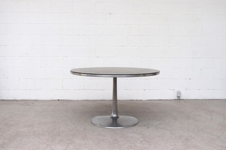 Impressive Poul Cadovius dining or center table with striking ornate surface with an aluminum pedestal base. In original condition with some wear and visible scratching consistent with use and age. Other sizes (LU922418398332, LU922418398202) and